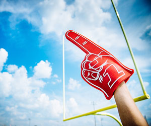 This is a photo of a person wearing a #1 foam finger.