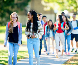 This is a photo of a group of teens walking to school.