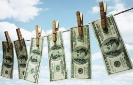 Hundred dollar bills hanging from a clothesline