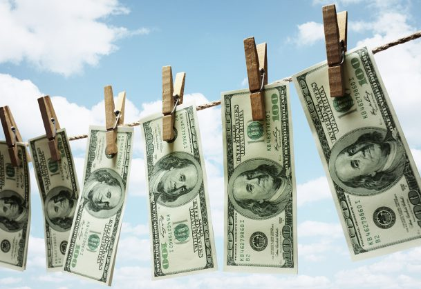 Hundred dollar bills hanging from a clothesline