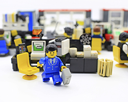 This is a photo of a LEGO businessman in a LEGO office.