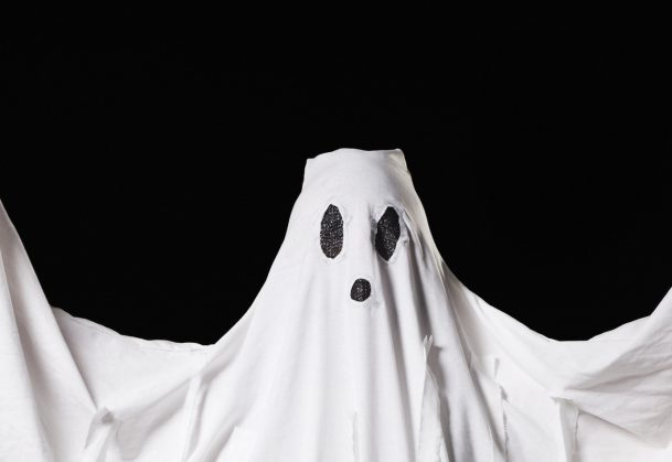 """A """"ghost,"""" ora white sheet with drawn black eyes and a mouth (with a human underneath)."""
