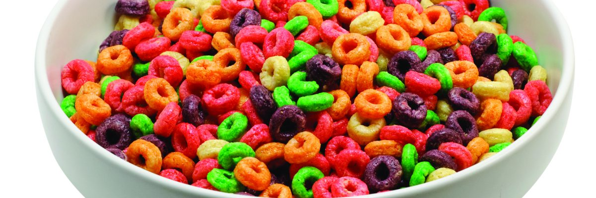 A picture of a bowl of fruity cereal.