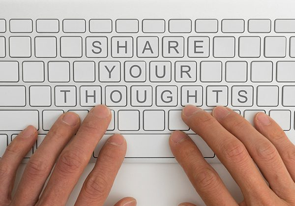 "This is an image of hands at a keyboard and the keys spell out ""Share Your Thoughts"""