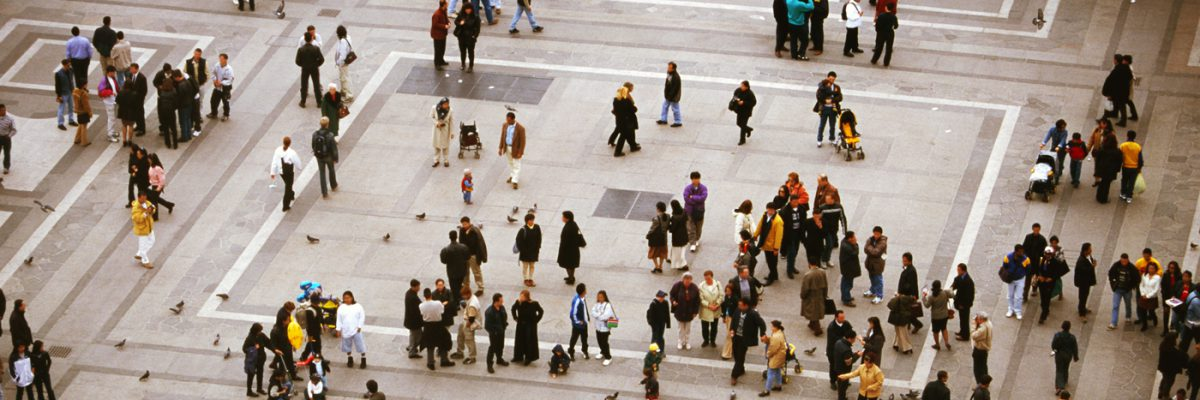 Elevated view of people walking in a square