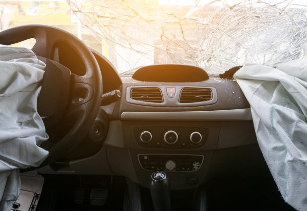 Damaged car dashboard with airbags deployed