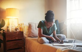 Full length shot of a young female student studying at home