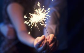 This is a photo of a couple holding sparklers