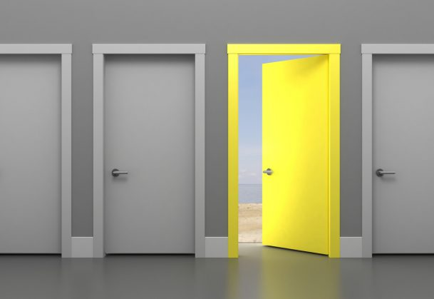 This is an illustration of a series of gray doors with one open yellow door.