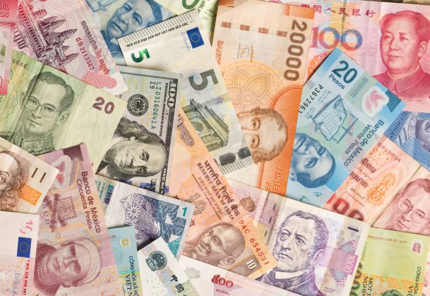This is a photo of a colorful variation and collection of international currency.