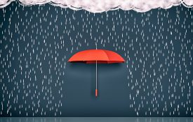 This is an illustration of a red umbrella blocking rainfall against a dark background