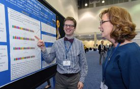 Dapper poster presenter from past APS convention.