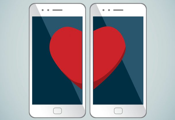This is an illustration showing two phones with matching heart halves.