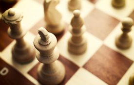 This is a photo of a chess board with chess pieces
