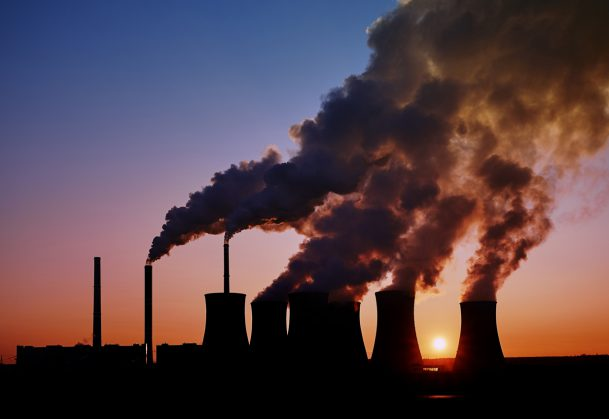 This is a photo of a coal-fired power station taken at sunset.