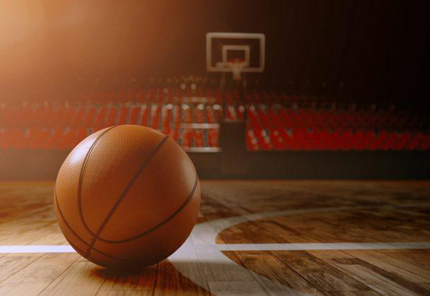 Basketball lying on shiny court