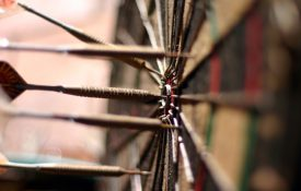 This is a photo of a dartboard with darts.