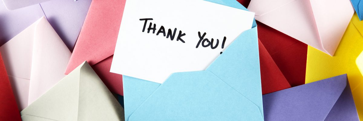 Thank You note in blue envelope.