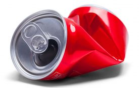 This is a photo of a crumpled soda can