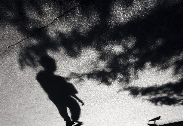 Blurry shadow of a boy in black and white