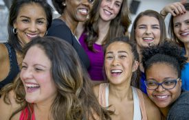 A diverse group of women laughing