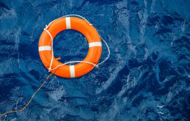 Life preserver ring floating in water
