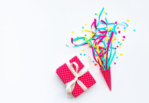 Colorful confetti,streamers and gift box.Flat lay