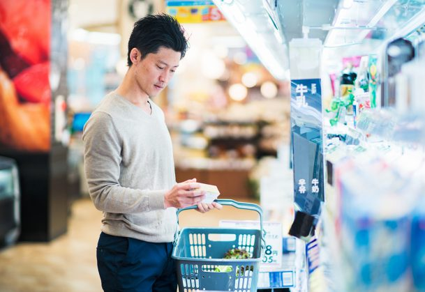 This is a photo of an adult male grocery shopping in a supermarket