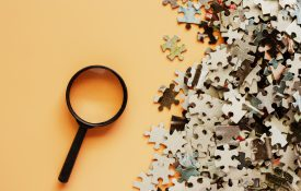 magnifying glass and puzzle pieces