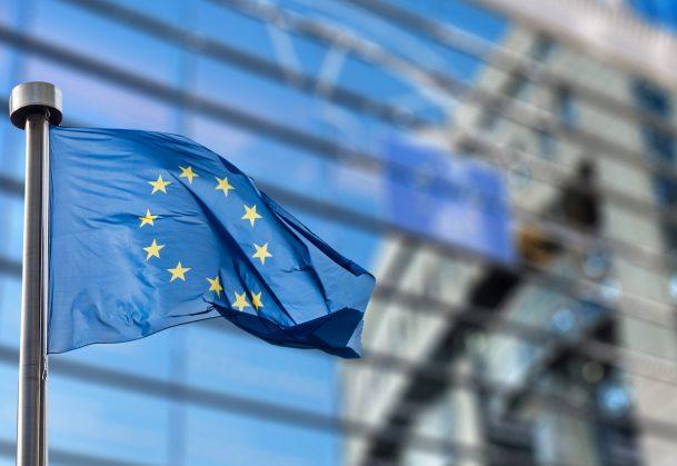 European Union flag against a building backdrop