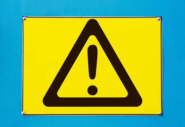 Outdoor attention sign - yellow triangle with exclamation.