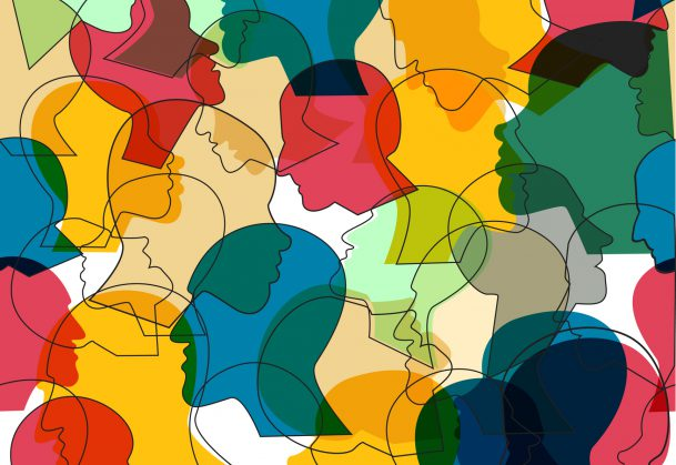 Seamless pattern of a crowd of many different people profile heads.