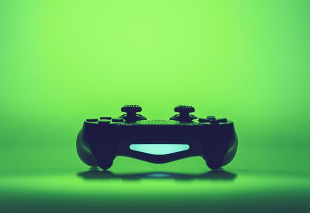 Video game controller on a vivid green background