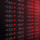 Photo of a stock ticker board showing losses