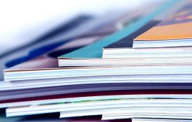 Stack of Books image representing APS Journals