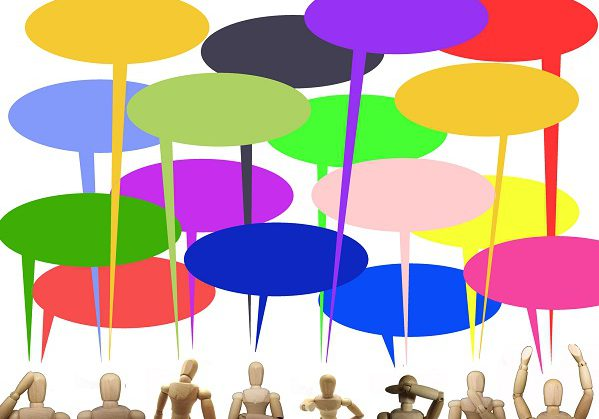 Picture of mannequins with speech bubbles above them, represents the APS Roundtable discussion.