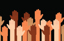 A picture of raised hands, signifying our willingness to listen to diverse voices on the subject of equity and justice.